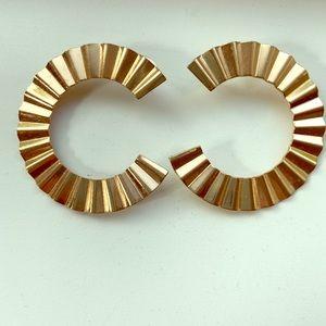 Gold C shape earrings